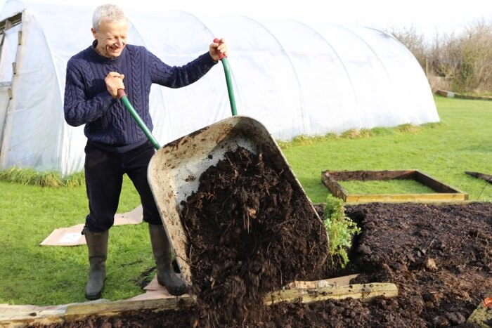 Charles tips out homemade compost, new no dig bed