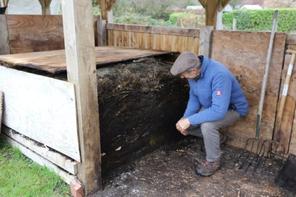 Charles examines a compost heap profile