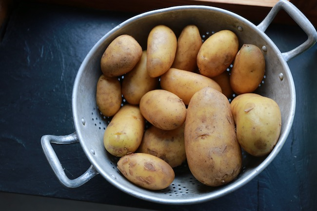 After cleaning and washing the potatoes