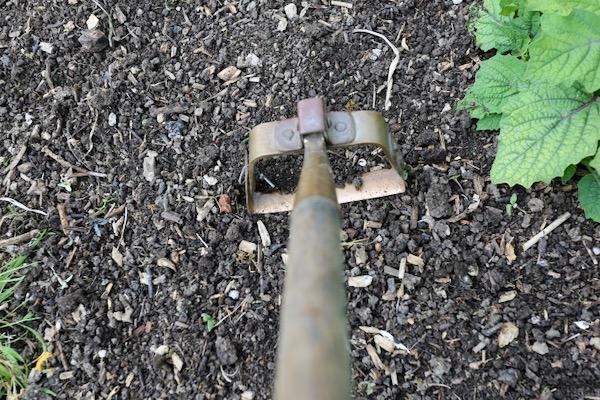 Copper swivel hoe cuts weed stems