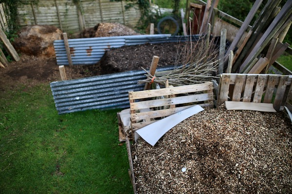 Piles of wood chip and mature compost