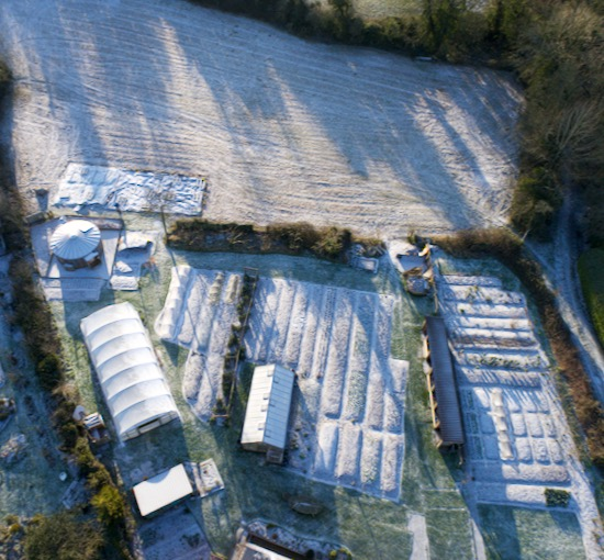 Drone view of Homeacres in frost and snow