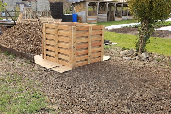 Wired at the corners, new compost heap from pallets