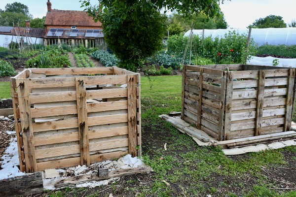 Compost heaps of pallets simply wired together, no stakes