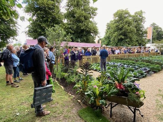 Hampton garden and Charles talking, huge crowds