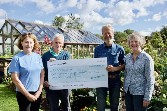 Promise Works receiving £1910 from Charles' open day